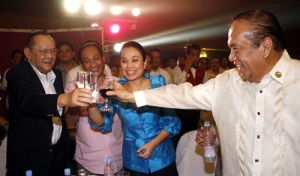 Danding Cojuangco (in suit) having a toast with NPC partymates